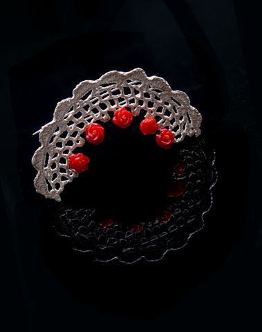 Brooch.  925 Silver, carved corals.